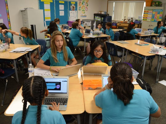 Students in Cindy Martinez' sixth grade class at Cielo Vista Charter research California ballot measures. Later they'll present to their classmates why to support them or not.