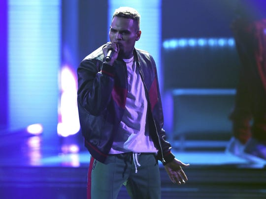 """In this Sunday, June 25, 2017, file photo, Chris Brown performs at the BET Awards at the Microsoft Theater in Los Angeles. Brown released a 45-song album """"Heartbreak on a Full Moon"""" on Tuesday, Oct. 31. (Photo by Matt Sayles/Invision/AP, File)"""