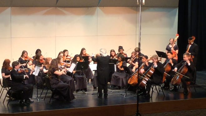 The Alexandria Youth Orchestra performs three pops pieces at the Windy City Classic in Chicago on April 10. The group, which under the direction of John De Chiaro, earned first place in the orchestra division and grand champion in the instrumental division.