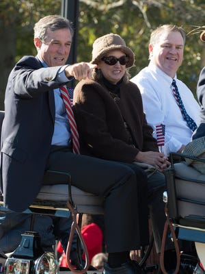 Governor-elect John Carney (left) rides with GOP opponent Colin Bonini (right) at the Return Day Parade in Georgetown.