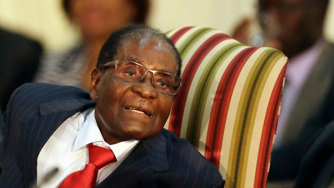 In this file photo dated Oct. 3, 2017, Zimbabwe's President Robert Mugabe, during his meeting with South African President Jacob Zuma, at the Presidential Guesthouse in Pretoria, South Africa.