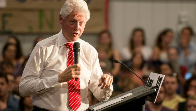 Former President Bill Clinton speaks on behalf of his wife to a full gymnasium Sunday March 13, 2016 during the Get Out the Vote event at Asheville High.