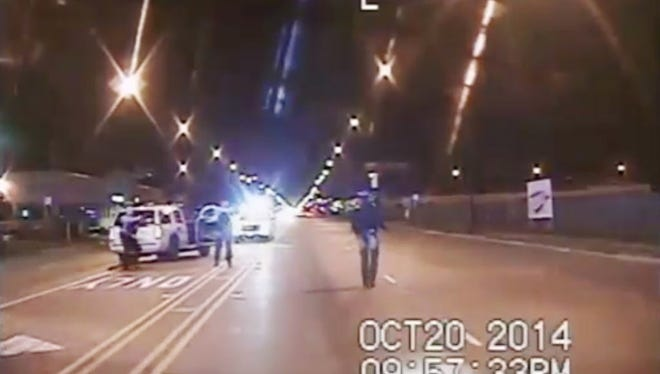 In this Oct. 20, 2014 frame from dash-cam video provided by the Chicago Police Department, Laquan McDonald, right, walks down the street moments before being fatally shot by CPD officer Jason Van Dyke sixteen times in Chicago. Police Superintendent Eddie Johnson filed charges Tuesday, Aug. 30, 2016, to fire Van Dyke along with four other CPD officers who were at the scene of the shooting.
