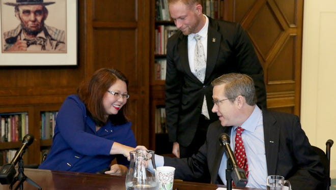 Rep. Tammy Duckworth and Sen. Mark Kirk shake hands after their debate on Oct. 3, 3016, in the Chicago Tribune editorial board room.