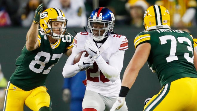 New York Giants' Janoris Jenkins runs back his interception in front of Green Bay Packers' Jordy Nelson during the first half of an NFL football game Sunday, Oct. 9, 2016, in Green Bay, Wis.