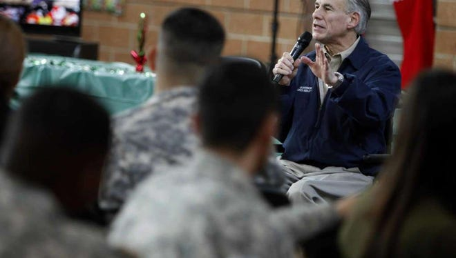 Texas Gov. Greg Abbott addresses members of the Texas National Guard, who are deployed on the border of Mexico, Tuesday, Dec. 20, 2016, in Weslaco.