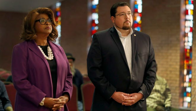 Ferguson Mayor James Knowles III, right, and councilwoman Ella Jones stand just off stage as they are introduced before a mayoral forum in Ferguson, Mo. on March 30, 2017.