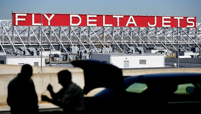 A Delta Air Lines sign overlooks a section of  Hartsfield-Jackson Atlanta International Airport, in Atlanta. Delta Air Lines reported financial earnings on Wednesday