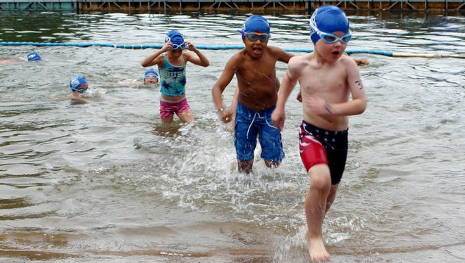 Swimmers exit the water Aug. 5, 2017, at the fourth annual Race4Chase kids triathlon finale in Southington, Conn. The Kowalski family began the Race4Chase program to honor their son, Chase Kowalski, who was among 20 first-graders killed on Dec. 14, 2012 at the Sandy Hook Elementary School in Newtown.