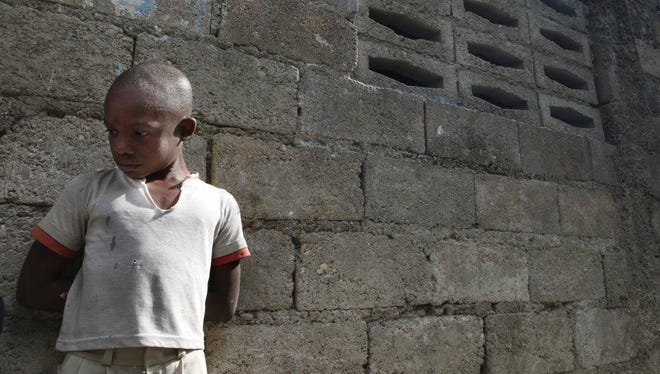 In Carrefour, Haiti, Thomas Feanelom, 11, returned to his school, where he was able to get food.