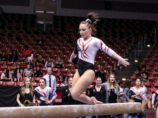 SUU Ana Jaworski performing on the Beam against Boise State & California in the Centrum on Friday.