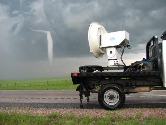 A University of Massachusetts radar truck observes a Wyoming tornado on June 5, 2009, during the VORTEX-2 campaign.
