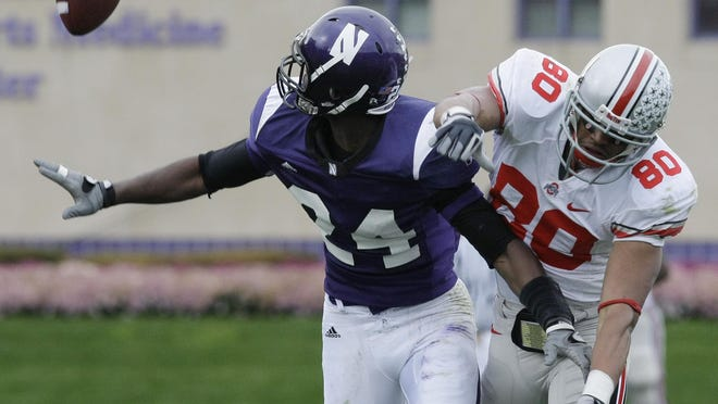 Northwestern cornerback Sherrick McManis, left, interferes with Ohio State wide receiver Brian Robiskie, right, during the second half of an NCAA college football game in  Evanston, Ill., Saturday, Nov. 8, 2008. Robiskie had two touchdown receptions in the Buckeyes 45-10 win.