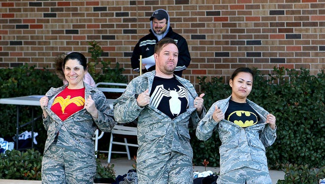 """Members of the """"Ice Medics"""" show off their costumes before jumping into the Midwestern State University's Wellness Center pool Saturday morning as part of the Polar Plunge."""