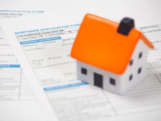 Foam house on top of mortgage application form