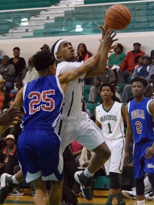 Peabody's Jacoby Ross (5, right) goes for two against Vidalia's Julius Wilson (25, left). Peabody earned the No. 1 seed in Class 3A.