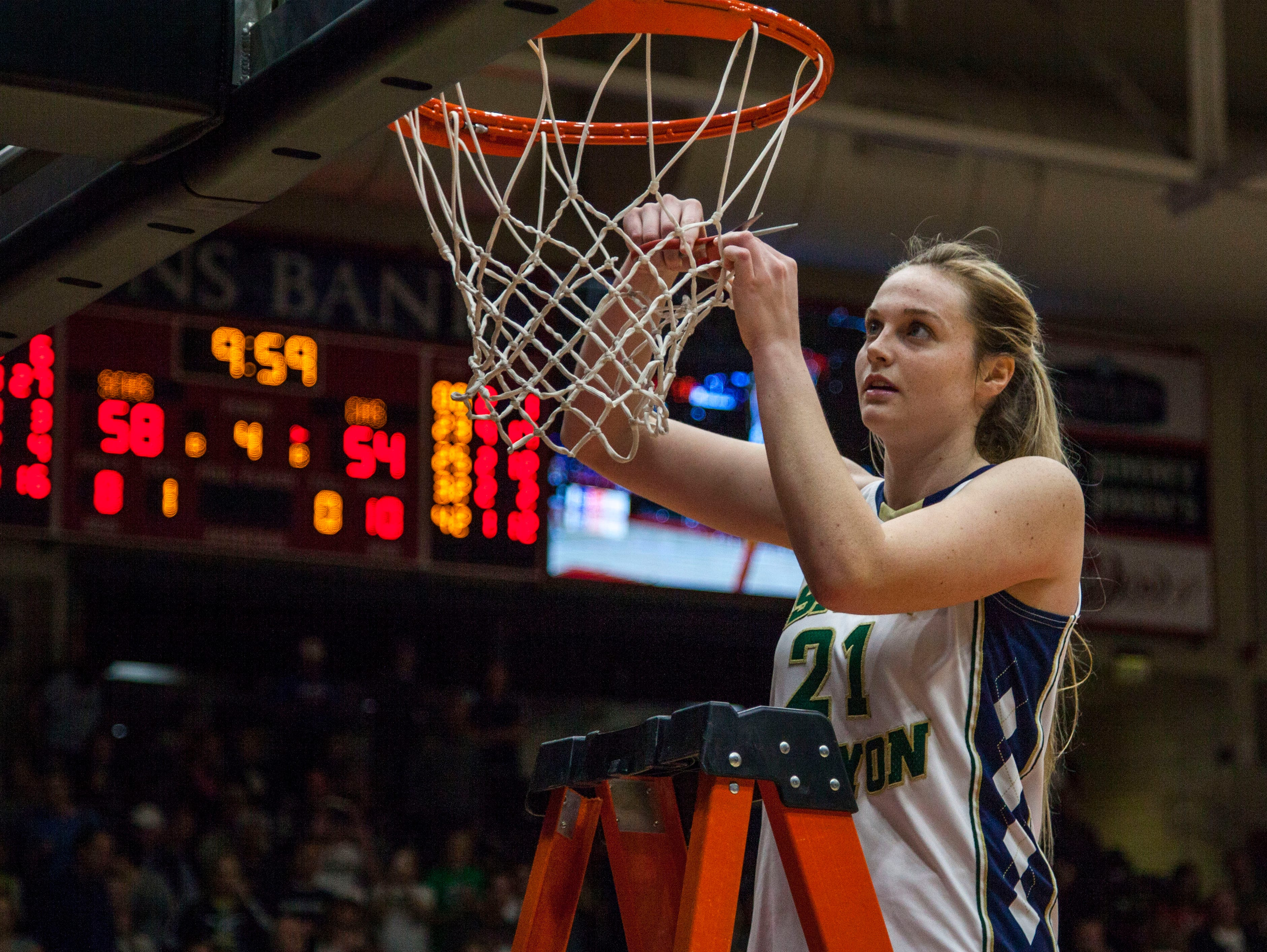Snow Canyon's Madison Mooring celebrates winning the 3A championship game by cutting a piece of the net in the SUU Centrum, Feb. 27, 2016.