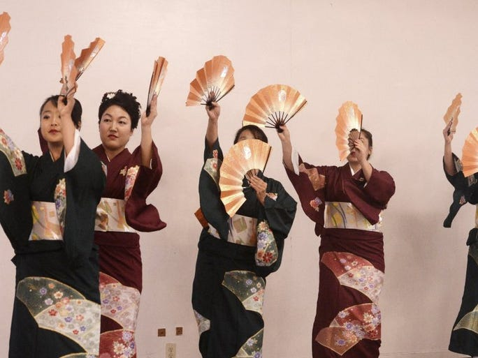 CHUCK KIRMAN/THE STAR Japanese dancers perform during Saturday's Obon Festival at the Oxnard Buddhist Temple.