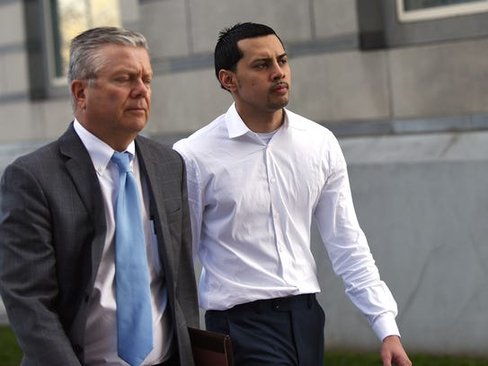 Paterson City police officer Ruben McAusland appears