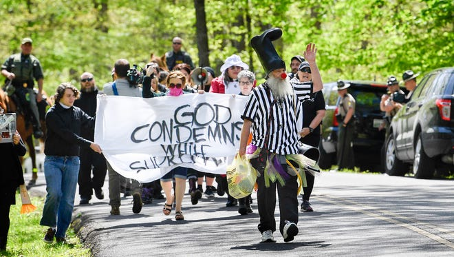 Vermin Supreme, right joins the other anti-racist organizations to march into the park to protest the annual American Renaissance conference at the Montgomery Bell State Park in Burns, Tenn., Saturday, April 28, 2018.