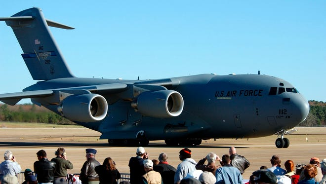 In this file photo, people watch as a C-17 Globemaster III taxies into a parking position in Jackson, Miss.