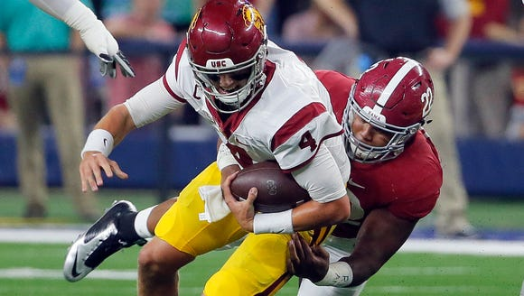 Southern California quarterback Max Browne (4) is sacked