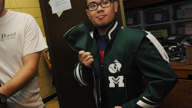 Marching band uniforms, shown in 2012 on Phil Chung, have the former Hurons logo to highlight Eastern Michigan history.