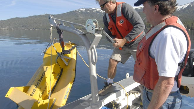 Neal Driscoll of the Scripps Institution of Oceanography, left, and Graham Kent, director of the Nevada Seismological Laborary, lower a sonar device into Lake Tahoe in 2011 to map underwater earthquake faults. Kent is now studying the possibility that Tahoe earthquakes could be linked to major quakes in the Pacific Northwest.