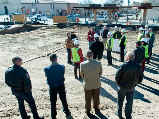 City and county leaders take a walking tour of the construction site for the downtown plaza Monday. The city spent $1.42 million buy the land for the plaza. Another $4.26 million is in escrow, being paid out to Las Cruces Community Partners as work is completed.