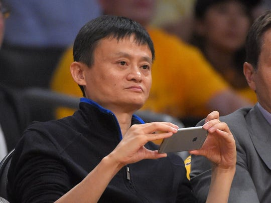 Jack Ma, executive chairman of Alibaba Group, watches