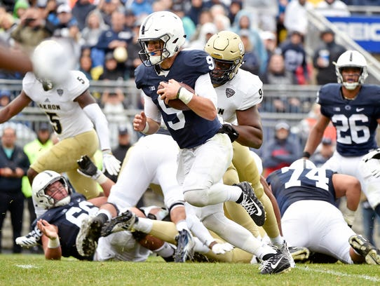 Penn State quarterback Trace McSorley carries for a
