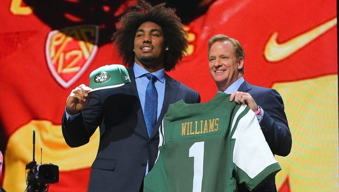 Leonard Williams (Southern California) poses for a photo with NFL commissioner Roger Goodell after being selected as the number sixth overall pick to the New York Jets in the first round of the 2015 NFL Draft at the Auditorium Theatre of Roosevelt University.
