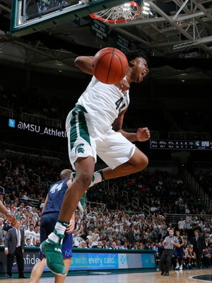 Michigan State's Nick Ward celebrates as he comes down from a dunk against Northwood during the second half of an exhibition Thursday, Oct. 27, 2016, in East Lansing.