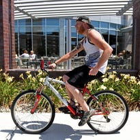 Johnny Carino's has taken several steps to draw bike trail users, including the installation of bike racks and promotional signs.