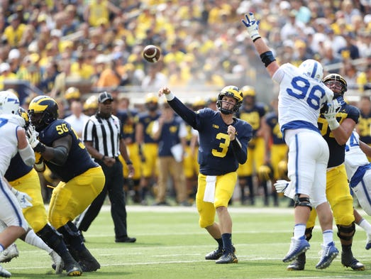 Wilton Speight passes in the third quarter of Michigan's