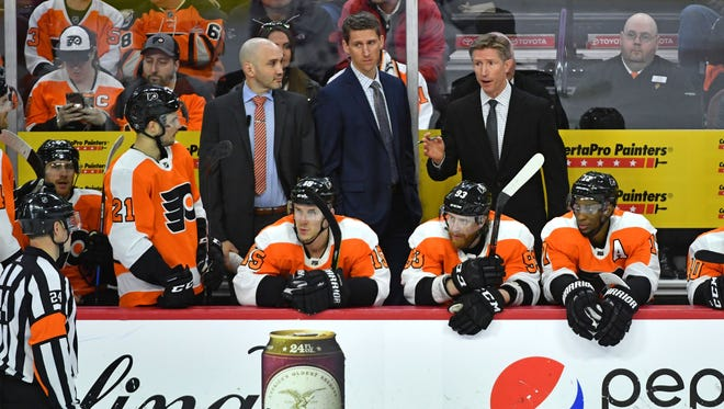 Dave Hakstol, back right, ordered up a few changes before the Flyers faced the Hurricanes Thursday.