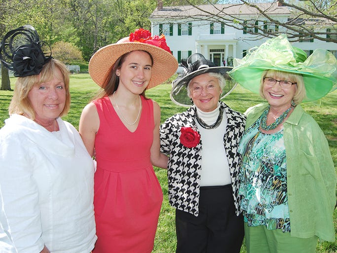 From left, Mary Ann Wainscott of Fort Mitchell, Christina Shuffett of Burlington, Sarah Kahmann of Burlington and Mary Sue Rudicill of Burlington pose for a photo during the Dinsmore Homestead Kentucky Derby Party held May 3 in Burlington. Guests watched the Run for the Roses on May 3 without leaving Northern Kentucky.