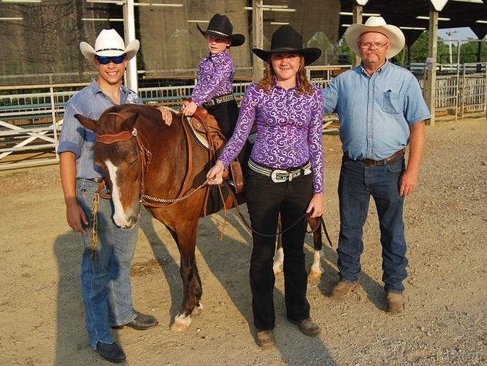 From left, Dustin Fike, 17, of Hebron, Kylee Ryan, 6, of Crittenden,  Hannah Case, 18, of Walton and grandpa Zeke Ryan prepare to compete in  the lead line class during the Boone County 4-H and Utopia Fair on Monday,  Aug. 4, 2014, in Burlington.
