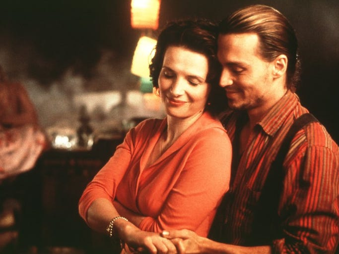 "Juliette Binoche and Johnny Depp in a scene from the 2000 film ""Chocolat."""
