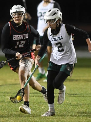 Micki Pippett of Viera scoops up the ball before Edgewood's Meghan George can get there during their game Wednesday.