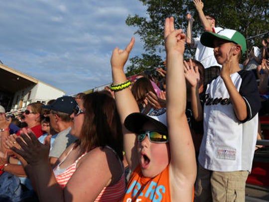 Brady Heiser, 6, of Rib Lake, lifts his arms in triumph
