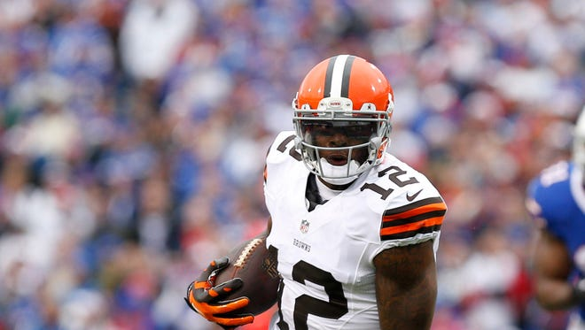 Nov 30, 2014; Orchard Park, NY, USA; Cleveland Browns wide receiver Josh Gordon (12) carries the ball against the Buffalo Bills during the first half at Ralph Wilson Stadium.