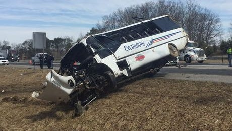 A tour bus carrying the Indiana Tech bowling teams overturned near Henryville on I-65 Thursday, March 12, 2015.