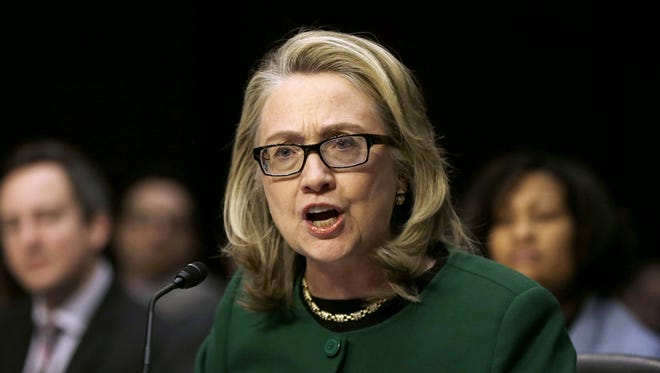 In this Jan. 23, 2013 photo, then-Secretary of State Hillary Rodham Clinton testifies on Capitol Hill in Washington, D.C. on the deadly September attack on the U.S. diplomatic mission in Benghazi, Libya, that killed Ambassador Chris Stevens and three other Americans.