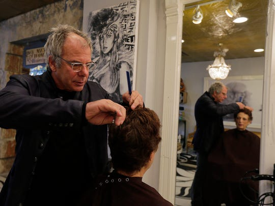 Glen Goldbaum, owner of Lambs & Wolves, cuts the hair of Nancy Bulone of Staten Island, NY at his salon in Red Bank, NJ Thursday, October 27, 2016.