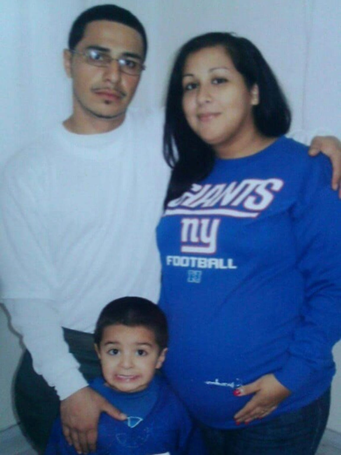 Norman Velez and his family show their Big Blue pride.