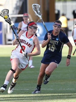 Stony Point native Tara Monaghan (2), pictured here in the 2015 NCAA Division-III women's lacrosse national title game, was named the IWLCA D-III Midfielder of Year.