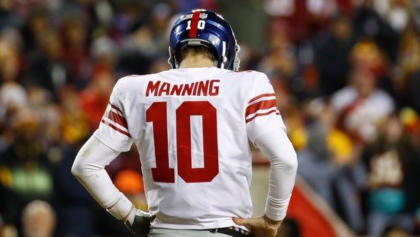 New York Giants quarterback Eli Manning (10) looks