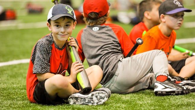 Kagan Boone at the Cajuns baseball host Father and Son Baseball camp at Tigue Moore Field.