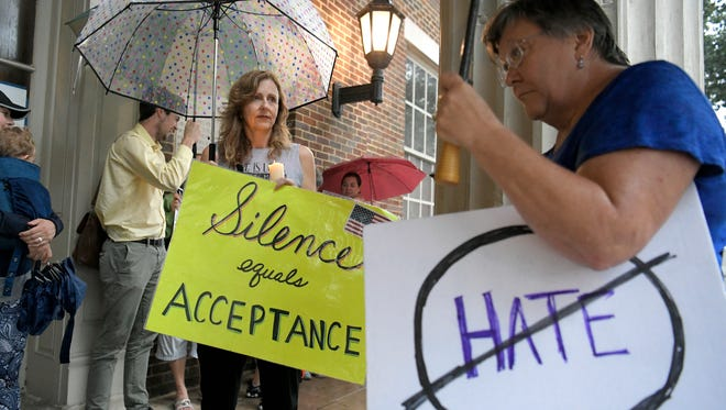 People attend a Stand in Solidarity with Charlottesville peace rally on the downtown square in Franklin on Monday, Aug. 14, 2017.